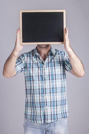 Man holding a blackboard