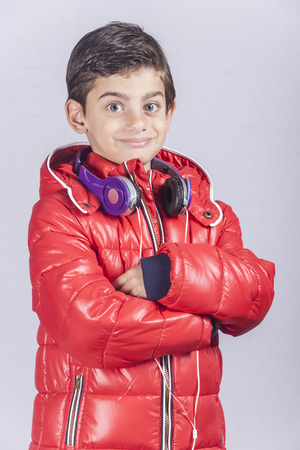 new age music: Portrait of a trendy boy posing with headphones Stock Photo