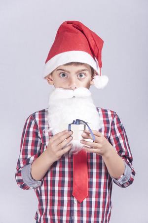 suprise: Little Santa Claus holding a gift box