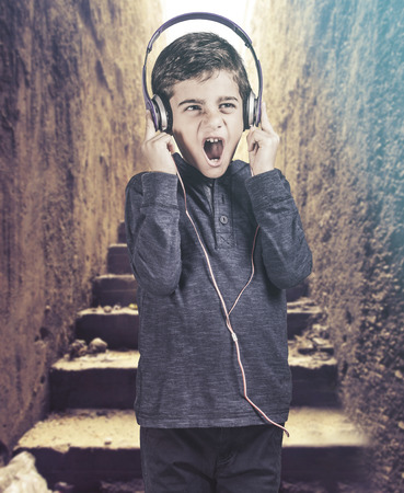 reacts: Boy reacts while listening to great music. Stock Photo