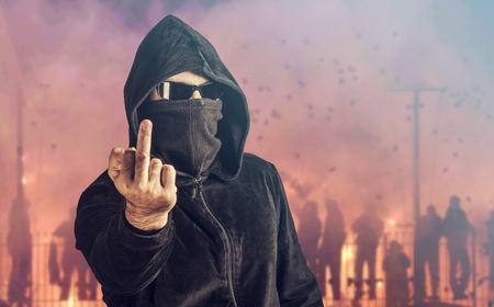 violent: Angry hooligan showing the middle finger. Stock Photo