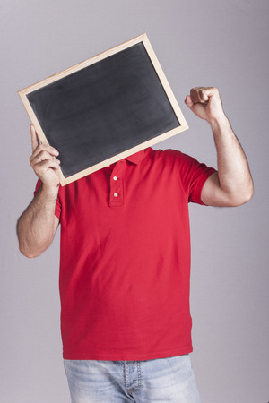 oportunity: Man holding a blackboard in front of his face