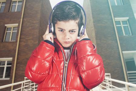 new age music: Trendy boy with headphones.