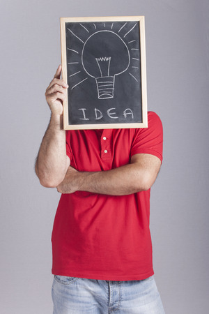oportunity: Man holding a blackboard. Innovation concept