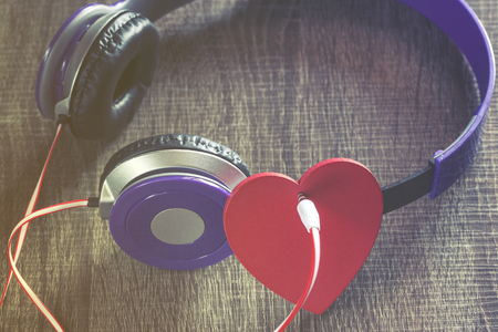 love image: Listen to your heart. Love and music concept. Selective focus image cross processed for vintage look Stock Photo