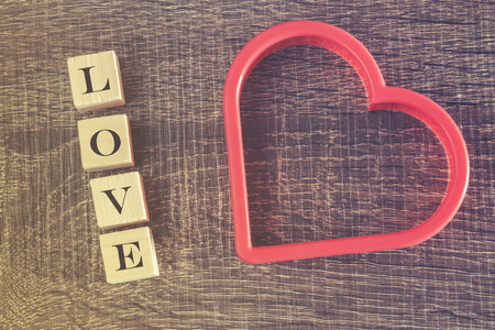 cross processed: Valentines day background with Love quote written in wooden blocks. Cross processed image with selective focus