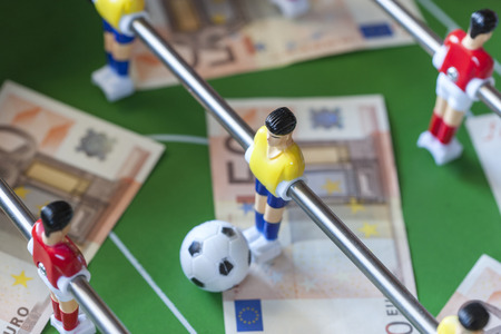 manipulated: Sports and money. Concept about money spending in football soccer, sports betting and manipulated fixed matches. Selective focus image
