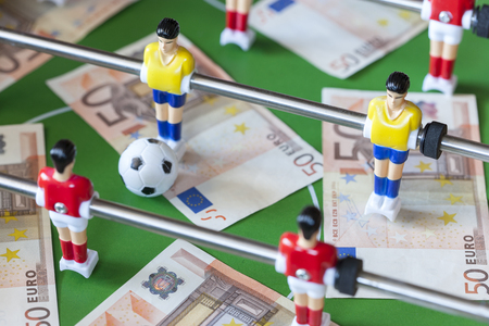 Sports and money. Concept about money spending in football soccer, sports betting and manipulated fixed matches. Selective focus image Stock Photo - 51650265