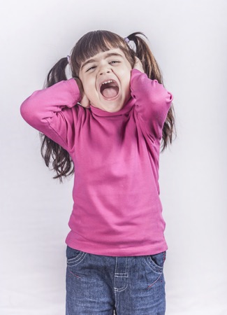 egoist: Little girl screaming. Toned image with shallow depth of field