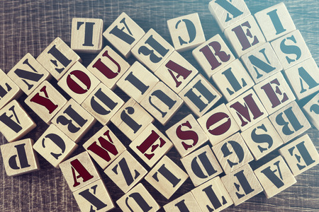 emotional love: You Are Awesome message formed with wooden blocks. Cross processed image for retro look Stock Photo