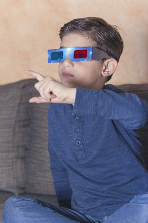 reacts: Little boy reacts while watching a 3D movie. Vintage effect image with shallow depth of field Stock Photo