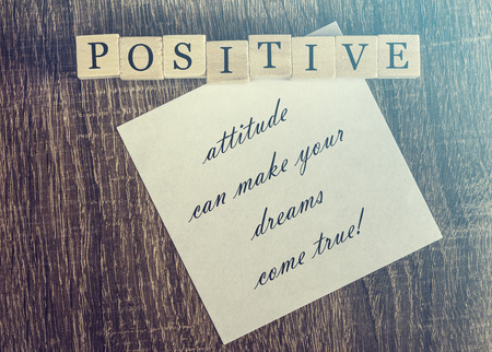 feeling positive: Positive attitude quote. Cross processed image for vintage feeling