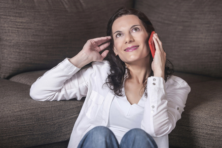 Beautiful middle aged woman talking to the phone Standard-Bild