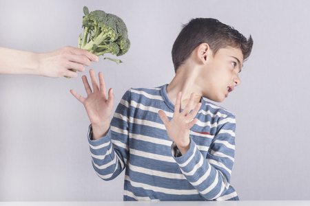 Little boy refusing to eat his vegetables Stock Photo - 55053014