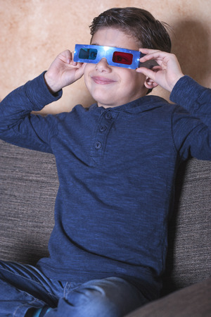 reacts: Little boy reacts while watching a 3D movie