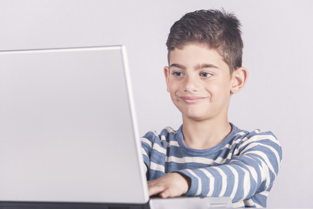 e learning: Young boy using a laptop computer (e learning concept) Stock Photo