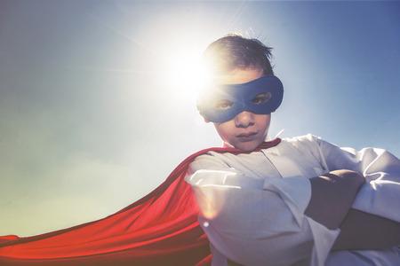 unbeatable: Superhero boy concept. Retro toned image with selective focus Stock Photo