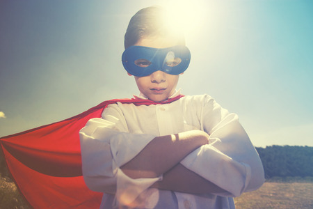 unstoppable: Superhero kid concept. Retro toned image with selective focus Stock Photo