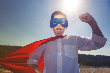 unbeatable: Superhero kid concept. Retro toned image with selective focus Stock Photo