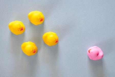 Discrimination concept with different color rubber ducks Stock Photo