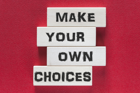 own: Make your own choices. Motivational message written on wooden tiles