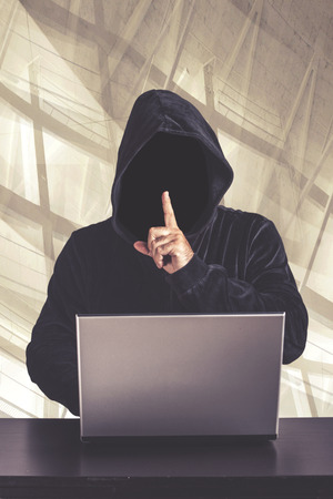 Hacker with laptop. Internet security concept