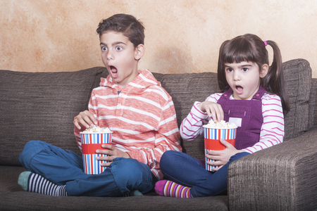 inappropriate: Shocked little kids react while watching inappropriate content on television