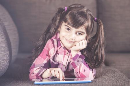 Cute little girl using a tablet