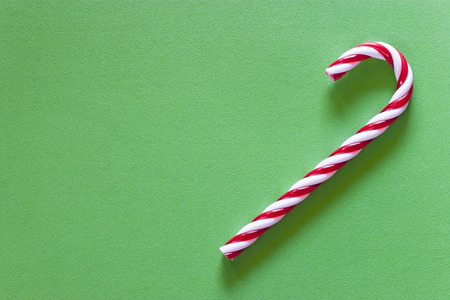 Christmas candy on a green background with copy space. Top view Stock Photo - 112521797