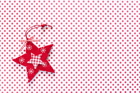 Christmas star on polka dots background with copy space. Top view Stock Photo