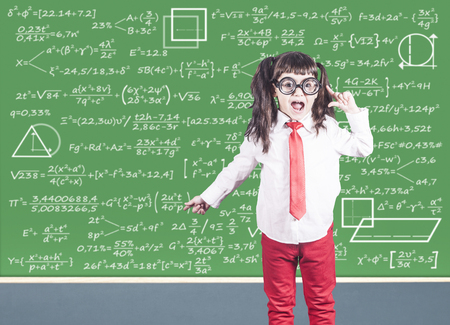 Education concept with funny smart school girl in front of a chalkboard Stock Photo - 112521801