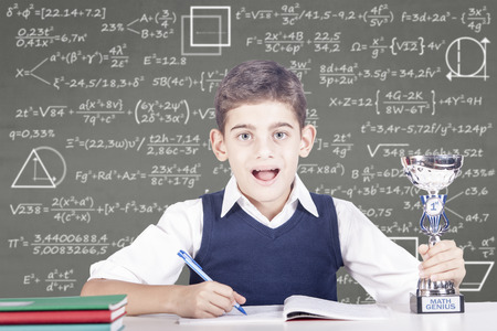 Education concept with genius school boy winner of a math competition Stock Photo - 112521802