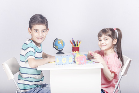 Kids playing and having fun together Stock Photo - 112521840