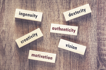 Motivational words written on wooden tiles