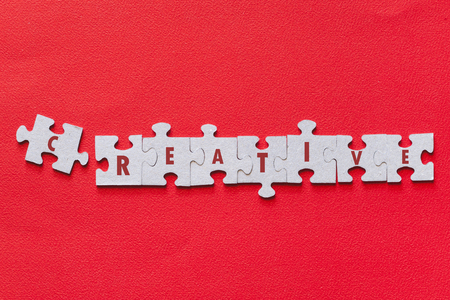 Word Creative written on puzzle pieces