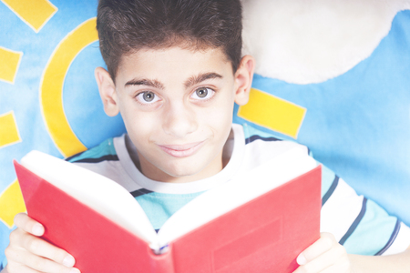 Little boy reading a book Stock Photo - 112521858