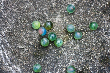 Playing marbles on asphalt road.