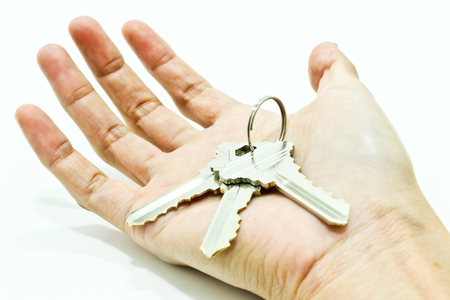 The Key in Hand Isolated on the White Background
