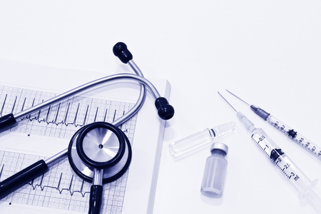 Stethoscope, Electrocardiography (ECG or EKG), Vial, Ampule of Drugs and Plastic Syringe with Needle Isolated on the White Background