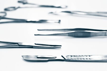 Surgical instruments isolated on the white background, focus on the scalpel blade Archivio Fotografico
