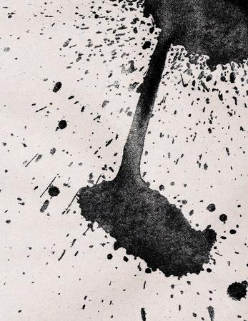 Splash shining ink on paper. Stock Photo