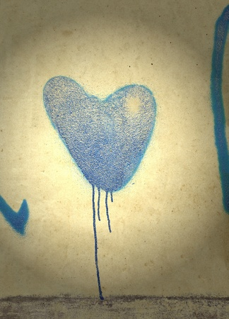 Blue heart on gloomy background