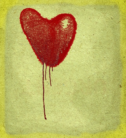 Bleeding heart on paper background with space for text. photo