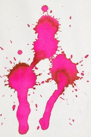 Red ink splash on paper