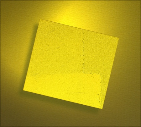 Yellow paper sheet on gold background