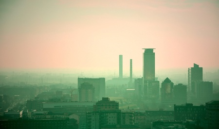 vanish: Polluted city skyline. Brescia, Italy. Stock Photo