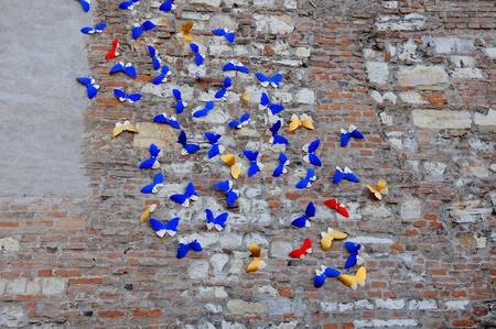 spontaneous: Butterflies shapes on medieval wall  Spontaneous street art  Stock Photo