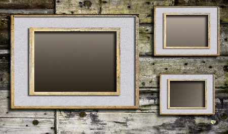 Cracked frames on wooden background
