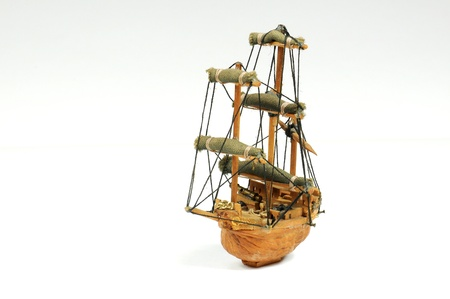 Old miniature sailboat made with a nut shell. photo