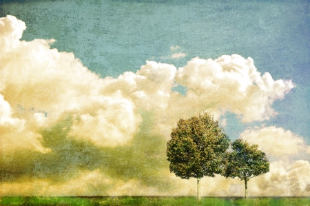 Surreal landscape with two trees and cloudy sky